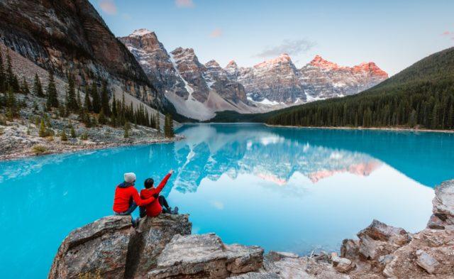 Couple looking at lake.