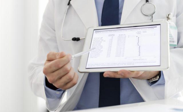 Clinician examining data on a tablet