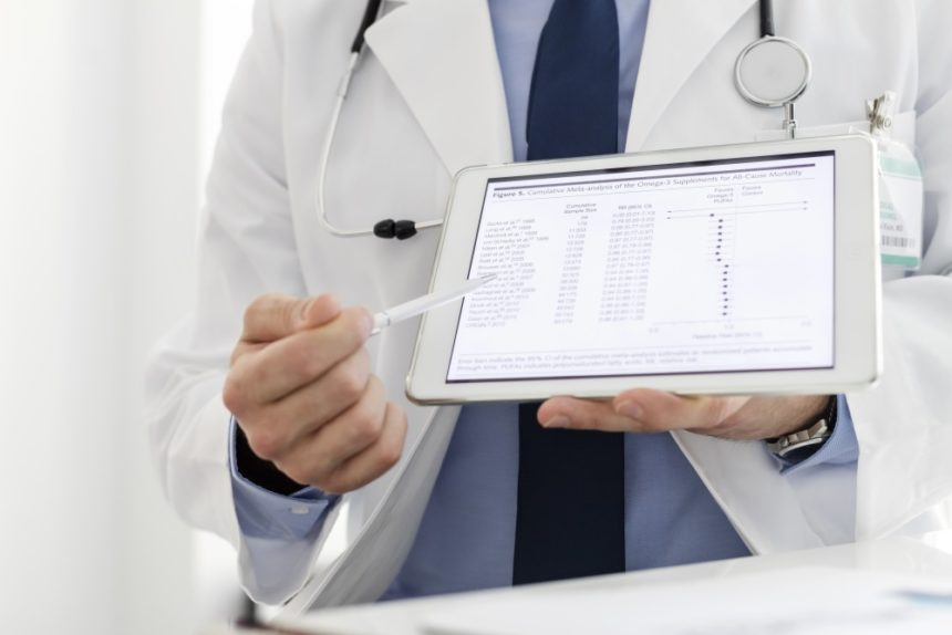 Clinician examining data on a tablet
