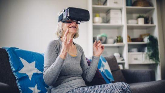 Elderly woman wearing VR headset.
