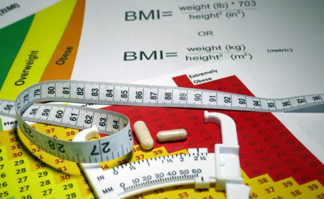 tape measure and BMI calculator