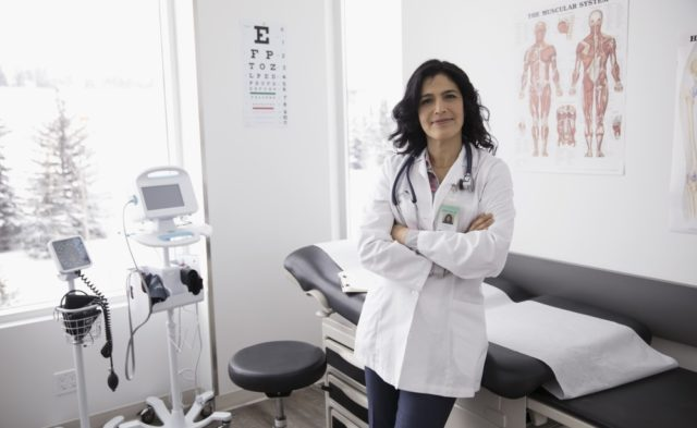 Female doctor standing confidently in office