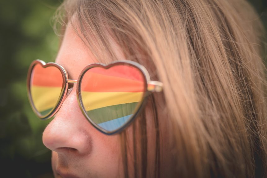 reflection of gay flag in sunglasses