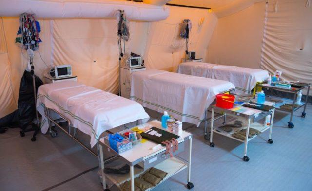 Cots inside a hospital tent