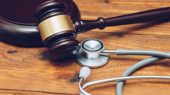 A judge's gavel with a stethoscope