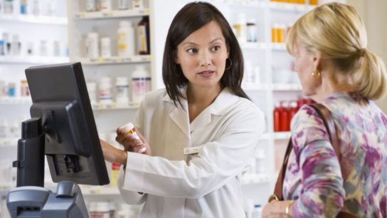 Pharmacist talking to customer