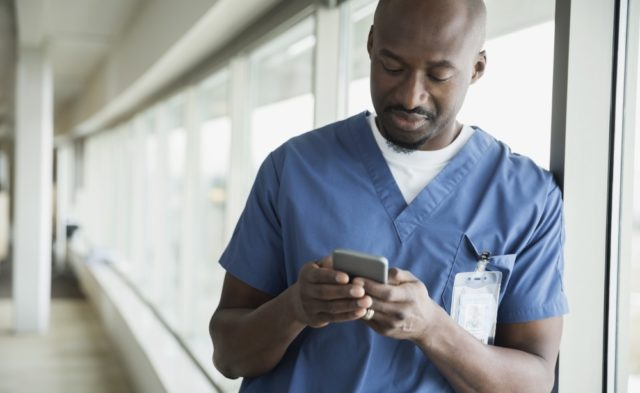 Physician using a smartphone at the hospital