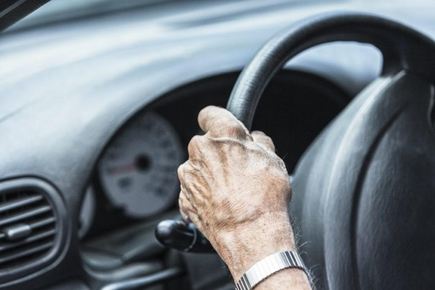 Elderly man with dementia driving a car