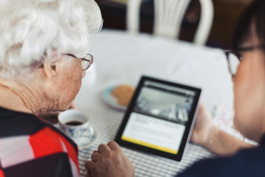 Senior woman using digital tablet at home.