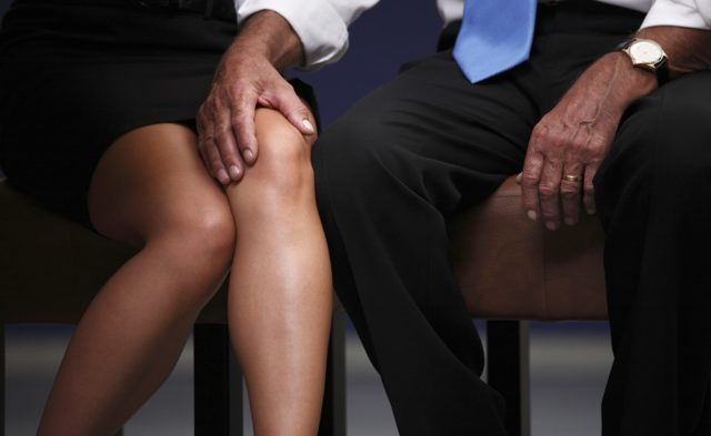 Man with his hand on woman's knee
