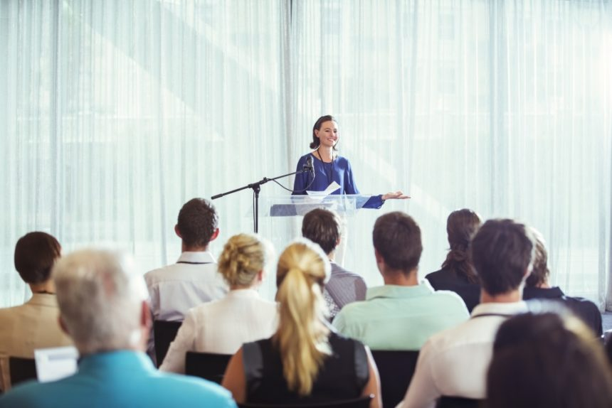 Woman presenting at a medical conference
