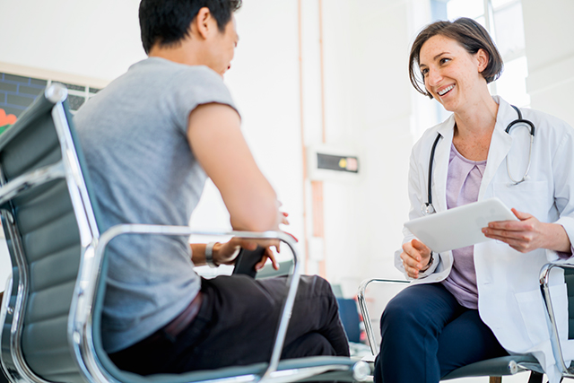 Conferring with a clinician about treatment options.