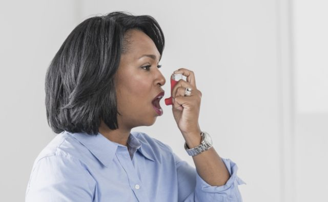 Woman with an asthma inhaler