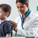 Young child and doctor, lung examination