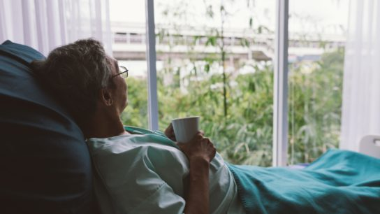 An older patient looks out the window.