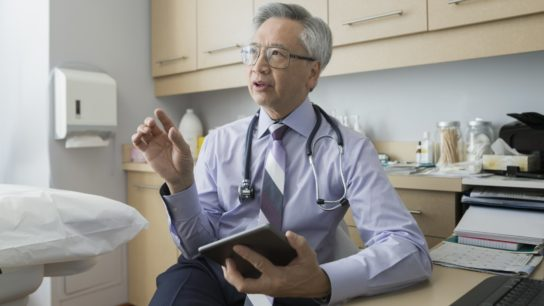Physician speaking to patient