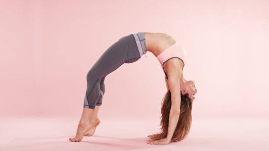A women performs a yoga posture,
