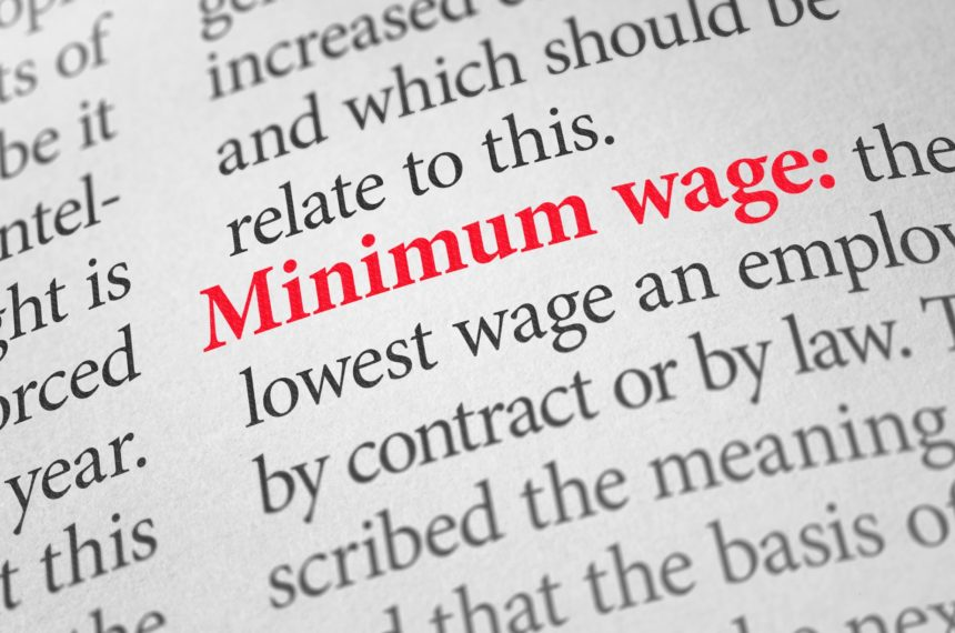 Dictionary page showing the definition of minimum wage.