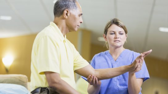 Man being seen by physical therapist