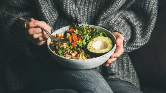 A woman with a bowl of food.