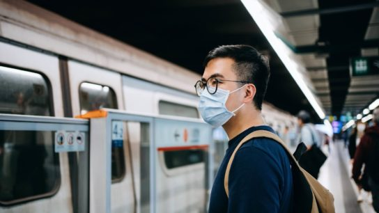 Young asian man wearing a protective face mask