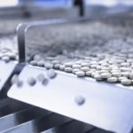 tablets in packing machine in pharmaceutical factory