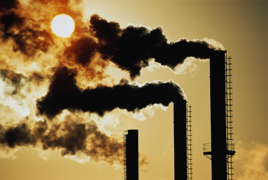 industrial chimneys emitting smoke