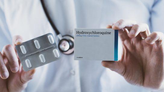 Doctor holding Hydroxychloroquine drug