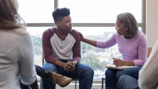 African American teenage boy in a counseling program,