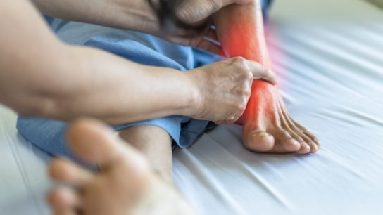 patient with ankle pain examined by doctor
