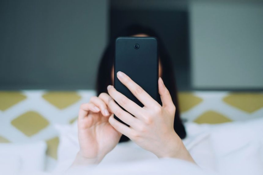 A woman using her smartphone.