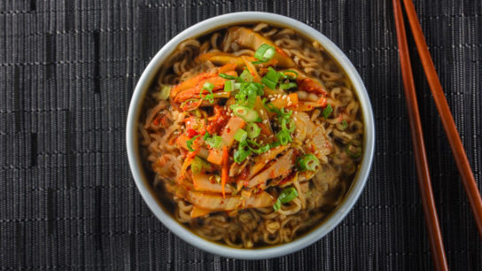 Bowl of noodles with kimchi on top